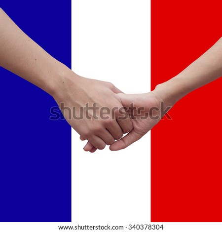 support and assistance human hands over France's flag background,helping hand concept. pray for Paris conception:strong together conceptual:assistance and support. - stock photo