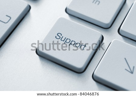 Support button on the keyboard. Toned Image.
