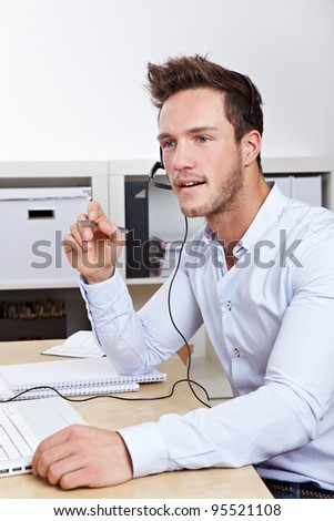 Support hotline call-agent working in call center with headset - stock photo