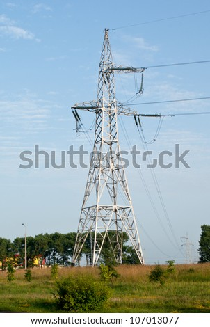 support of power line on blue sky