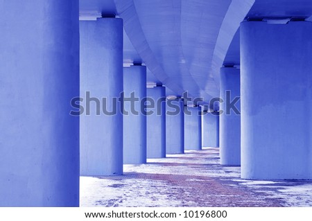 Support of the bridge in blue - stock photo