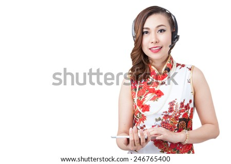Support phone operator in headset. using digital tablet computer PC happy isolated. Beautiful mixed race Asian with finger on touch screen display. / caucasian woman. Isolated on white background. - stock photo