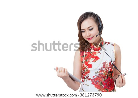 Support phone operator in headset. using digital tablet happy isolated on white background. Beautiful mixed race Asian with finger on touch screen display/Caucasian  woman. Isolated. - stock photo