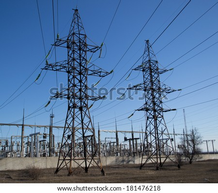 Support power lines and high voltage transformer  - stock photo