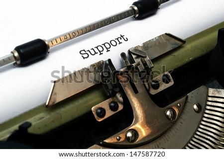 Support text on typewriter - stock photo