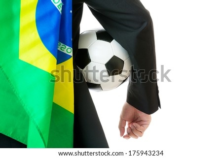 Supporter with brazil flag holding soccer ball