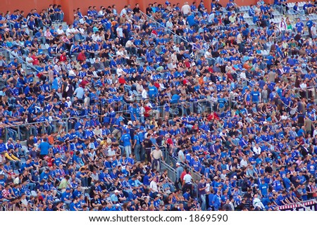 Supporters in blue - stock photo