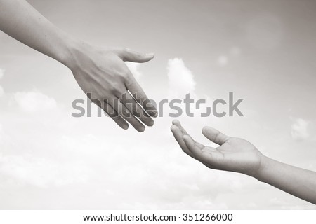 Supporting and aid of humanity.helping hand concept.hand of assistance.abstract helping hand in sepia gray vintage tone colored conception.love and kindness,tenderness conceptual.adore liberality. - stock photo