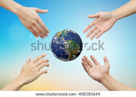 Supporting and assistance of Four hands reaching the world for heal together, save/safe the globe concept:carbon credits responsibility of business conceptual.Elements of this image furnished by NASA - stock photo