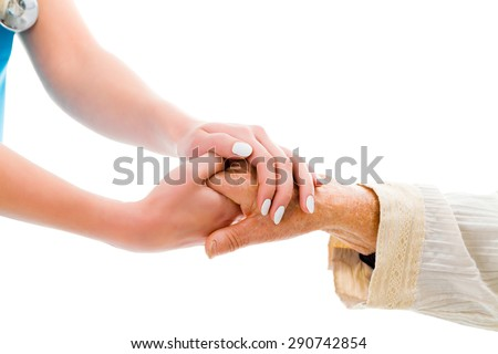 Supporting hands for senior woman - doctor and elderly patient. - stock photo