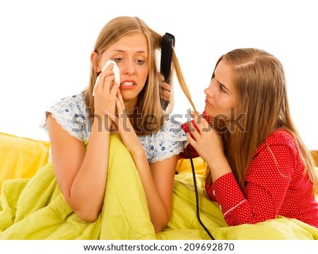 Supportive woman arranging girlfriend's hair when she is feeling down. - stock photo