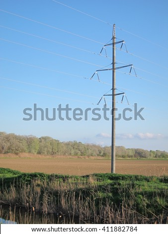 Supports power lines of 110 kV in the spring in a plowed field