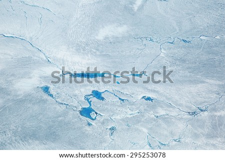 Supra glacial Lakes over the Ice Sheet in Greenland. Aerial Shot. - stock photo
