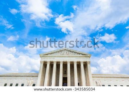Supreme Court Building with blue sky and white puffy clouds - stock photo