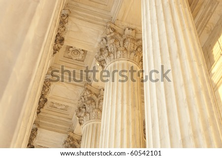 Supreme Court Column Details. Sunset orange light cast across scene. - stock photo