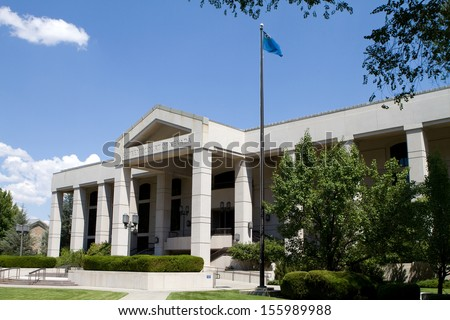 Supreme Court of Nevada building located in Carson City, NV against a blue sky. - stock photo