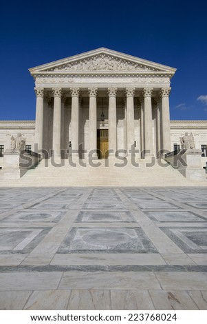 Supreme Court of the United States in Washington D,C. Blue sky behind.