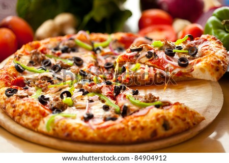 Supreme Pizza lifted slice 1 - stock photo