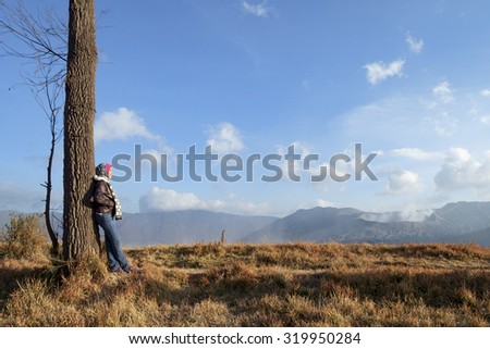 Surabaya, Indonesia-September 15, 2014: Unidentified International tourist pose for camera at the mountainside of Mount Bromo, Semeru, Tengger National Park, Indonesia.
