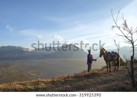 Surabaya, Indonesia-September 15, 2014: unidentified local people or Bromo Horseman pose for camera at the mountainside of Mount Bromo, Semeru, Tengger National Park, Indonesia.