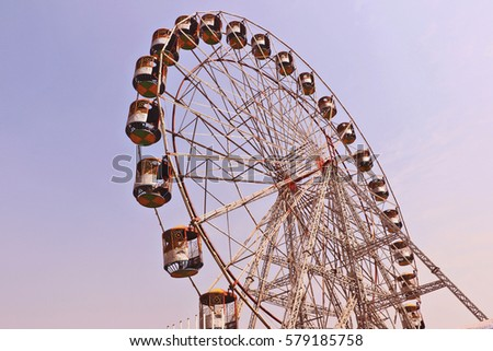 Surajkund, India - February 13, 2017:  Big Swing/Giant Wheels in Surajkund public craft fair in Surajkund, Faridabad, India. People are enjoying.