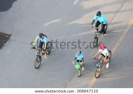 """SURAT THANI, THAILAND - AUGUST 16 : Top view of """"Bike for Mom event"""" on August 16, 2015 in Surat Thani, Thailand. Bike for Mom is the event for celebrates queen's birthday. - stock photo"""