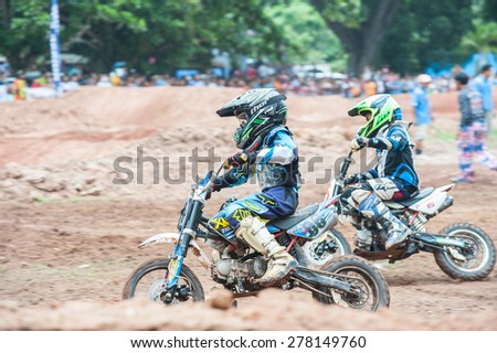 SURAT THANI THAILAND- Jul 20: The motorcross competition for charity and free fee to see .Among crowed of people to cheer up at BanhuoySork School on Jul 20, 2014 in surat thani province,Thailand