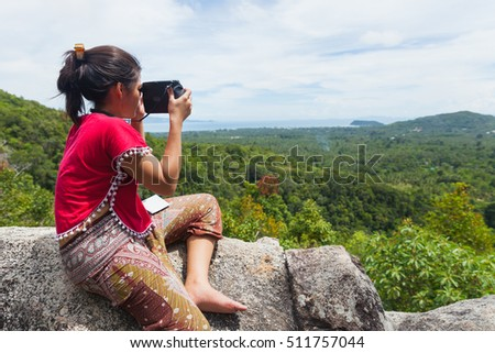 SURAT THANI, THAILAND - Jul 17 : Traveller Taking the picture of landscape view at Koh Phangan on July 17,2016 in Surat Thani, Thailand.