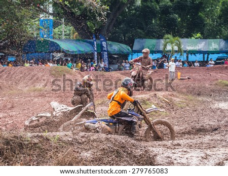 SURAT THANI THAILAND- Nov 22: The motorcross competition for charity and free fee to see .Among crowed of people to cheer up at BanhuoySork School on Nov 22, 2014 in Surat thani province,Thailand