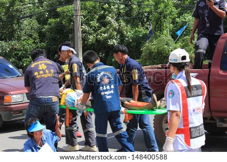 SURAT THANI, THAILAND - OCTOBER 4 : Practicing fire protection plan and rescue car accident on October 4, 2012 in Surat Thani, Thailand. - stock photo