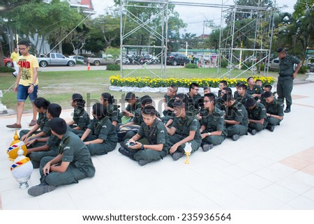 SURATTHANI, THAILAND- DEC 5:Unidentified soldier students in the celebration of the 87th birthday of King Bhumibol on December 5, 2014 in Suratthani,Thailand. King Bhumibol is respected by most Thais. - stock photo