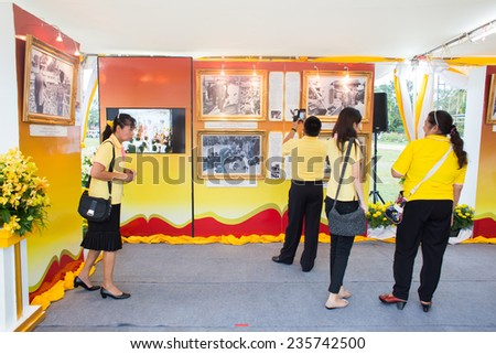 SURATTHANI, THAILAND - DECEMBER 5 : Unidentified people in exhibition about King Bhumibol on December 5, 2014 in Suratthani, Thailand. King Bhumibol is respected and revered by most Thais. - stock photo