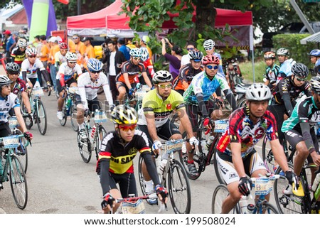 "SURATTHANI, THAILAND - JULY 7: Unidentified riders in action during ""Suratthani Bike Race 2013"" on July 7, 2013 in Suratthani, Thailand. It is a free, open, and un-ticketed event."
