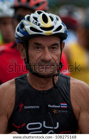 "SURATTHANI, THAILAND - JULY 8: Unknown rider   during ""Suratthani bike race 2012"" at Suratthani on July 8, 2012 in Suratthani, Thailand."