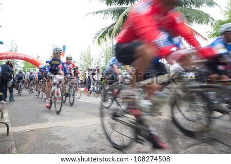 "SURATTHANI, THAILAND - JULY 8: Unknown riders in action during ""Suratthani bike race 2012"" at Suratthani on July 8, 2012 in Suratthani, Thailand. - stock photo"