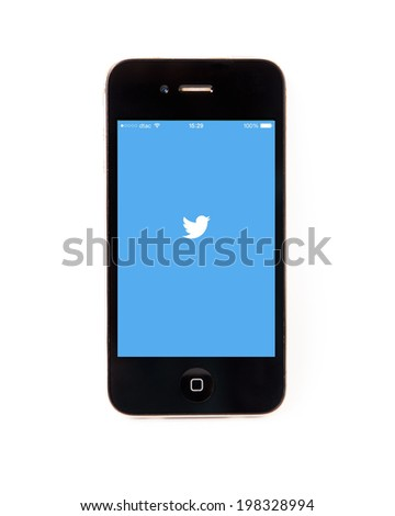 SURATTHANI THAILAND - JUNE 13,2014: Photo of twitter logo on iphone this application  as social network services such as micro-blogging. Users can send text messages longer than 140 characters. - stock photo