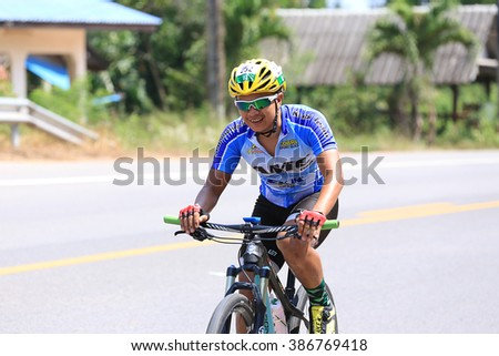 SURATTHANI, THAILAND - MARCH 6, 2016: Unidentified contestant in bikes Racing and Model race 120 km.Tour of Police 8 Activities Bikes Race 2016 Round 1.