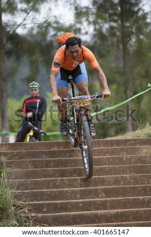 SURATTHANI, THAILAND - MARCH 27, 2016: Unidentified contestant in Suratthani Bike crosscountry in Thailand. 2016 Round 1.
