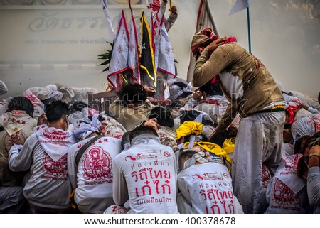 SURATTHANI, THAILAND - MARCH 23, 2016: Unidentified people in Religious ceremony who believe in Chinese god joined the walk parade in MARCH of every year.(vintage color tone style) - stock photo