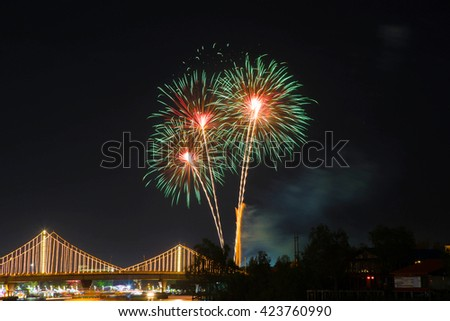 SURATTHANI, THAILAND - OCTOBER 17 : Beautiful firework display for celebration on the Tapee river on parades in Chak Phra Festival on October 17, 2015 in Suratthani, Thailand.