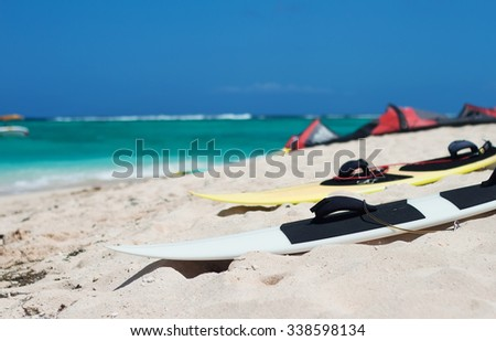 Surf board for kite on the beach of ocean. Selective focus - stock photo