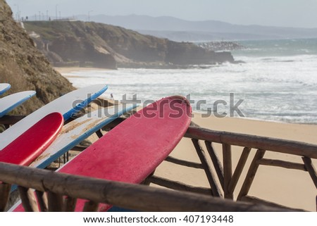 surf boards on beach - stock photo