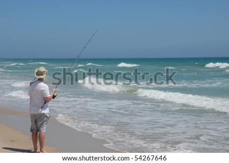 Beach fishing stock images royalty free images vectors for Florida surf fishing