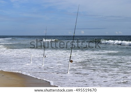 Surf fishing poles on the beach