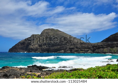 Surf flowing in towards coast - stock photo