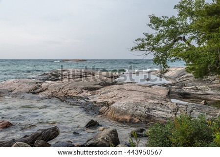Surf on pebble beach of Superior Lake, Canada