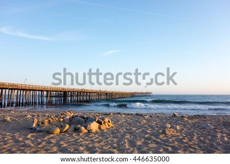 Surf waves near historic wooden pier in city of San Buena Ventura, Southern California - stock photo