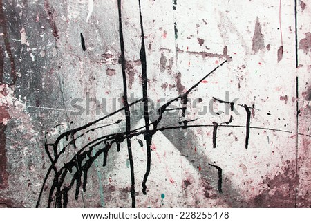 Surface covered with a multiple oil paint spills and spots as an abstract background composition - stock photo