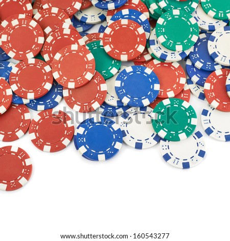 Surface covered with casino playing chips as a gambling background composition