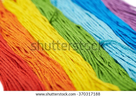 Surface covered with embroidery thread yarns - stock photo